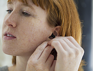 Lose the earbuds in favor of traditional headphones.